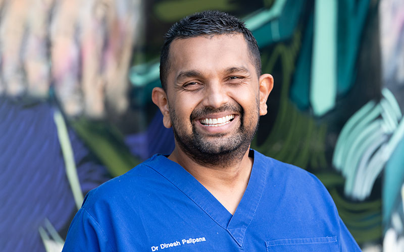 Dr Dinesh Palipana in blue hospital scrubs